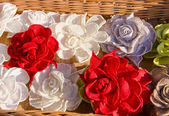 Handmade flax clothes roses — Stock Photo
