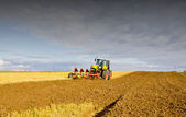 Agrarian landscape with tractor — Stock Photo
