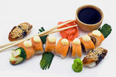 A Red Dragon Rolls Beside Sushi Eel with Wasabi, Chopsticks, Gin — Stock Photo