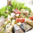 Salad with smoked herring - Stock Photo