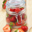 Stock Photo: Strawberries in jar