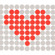Red heart shape made with white and red round pills - Stock Photo
