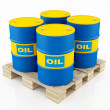 Blue and yellow oil barrels — Stock Photo