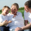 Стоковое фото: Happy young family with small child