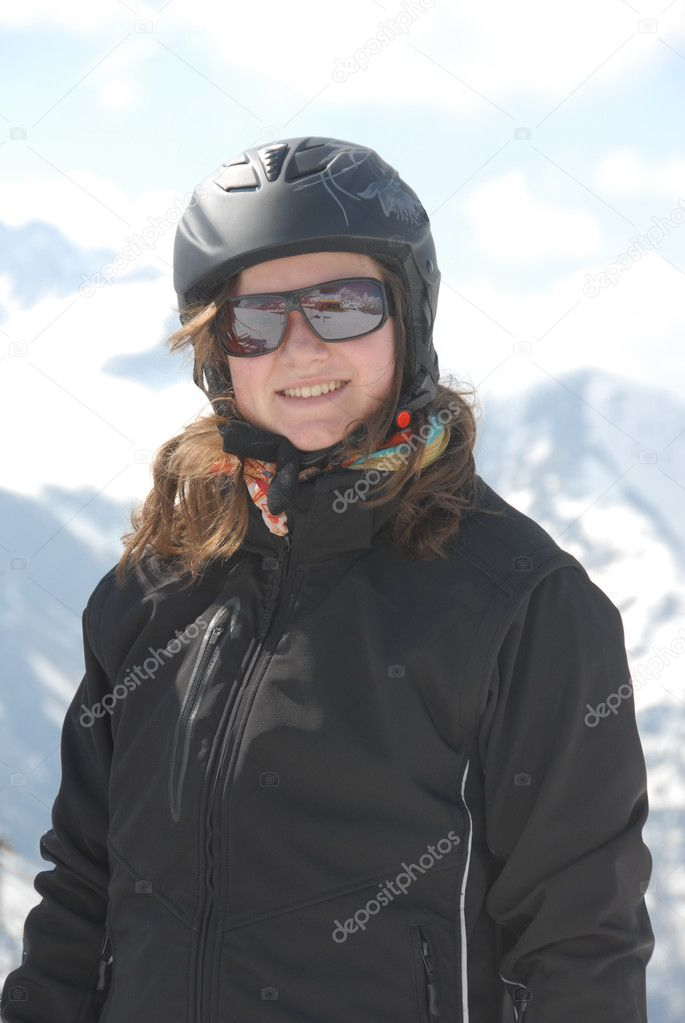 Portrait of a laughing  18 years old woman wearing ski helmet - mountain in the background — Stock Photo #6547974