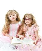 Twin princesses reading a book — Stock Photo