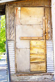Old shaky wooden door — Stock Photo