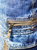 Close-up of denim trousers with patch pockets with zip — Stock Photo