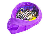 Purple ladies handbag with jewelry — Stock Photo