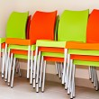 Stock Photo: Colorful chairs for visitors piled on each other and ranked