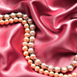 Stock Photo: Pearls satin