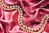 Pearls satin — Stock Photo