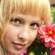 Attractive girl face with flowers — Stock Photo