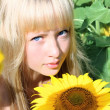 Portrait of a girl in sunflower field — Stock Photo