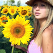 Young woman in subflowers field — Stock Photo