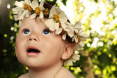 Baby with a wreath — Stock Photo