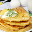 Stock Photo: Golden pancakes with sour cream