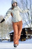 Winter leisure on skating rink. Sunny day, smiling beautiful girl skates. — Stock Photo