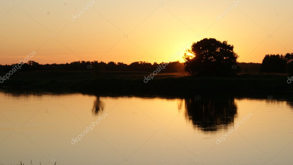 View of the sunset over the lake  Stock Photo #6309434