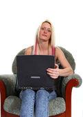 A woman using a laptop — Stock Photo