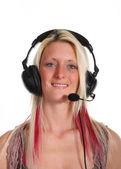 A woman wearing a headset — Stock Photo