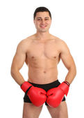 A guy covering his groin with boxing gloves — Stock Photo