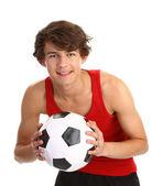 Guy holding football — Stockfoto