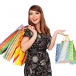Beautiful smiley woman with shopping bags — Foto de Stock