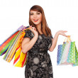 Beautiful smiley woman with shopping bags — ストック写真