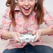 Girl playing video game — ストック写真