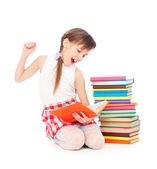 Drowsy little girl with books — Stock Photo