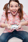 Girl playing video game — Stock Photo