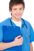 Young smiley nurse boy with stethoscope — Stock Photo