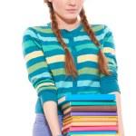 Girl holding books — Stock Photo