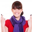 Smiley woman with fingers crossed — Stock Photo