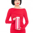 Woman in red dress holding gift — Stock Photo #5819891
