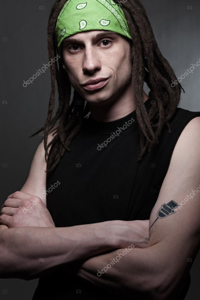 Portrait of man with dreadlocks over dark background — Stock Photo #5819843