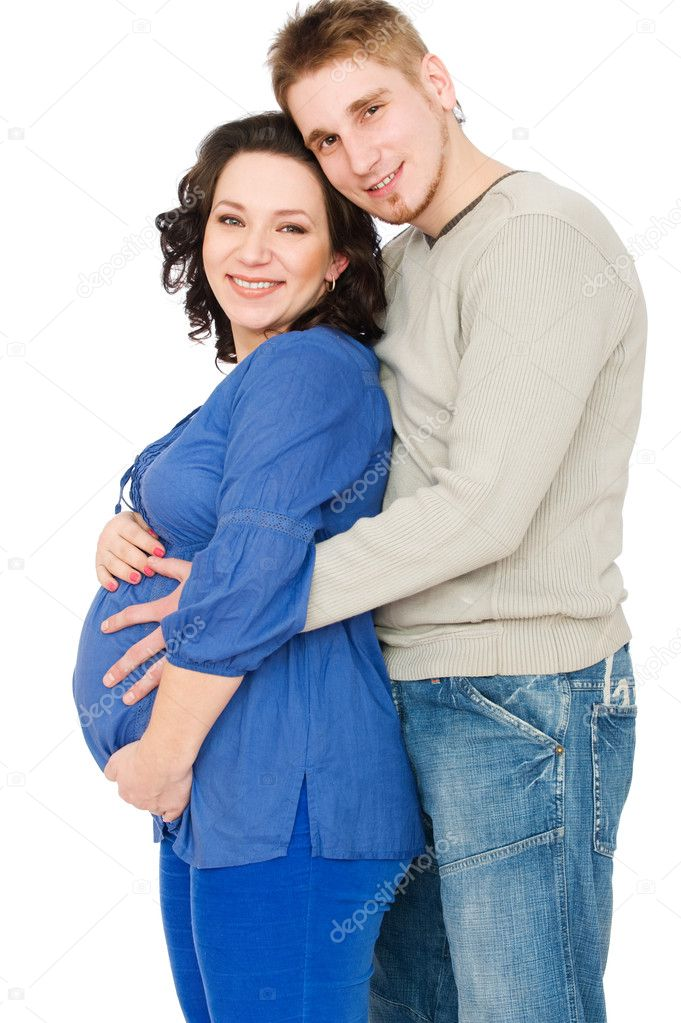 Portrait of smiling young pregnant woman with her husband beside her  — Stock Photo #6023014