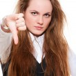 Young woman giving thumbs down — Stock Photo