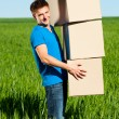 Man carrying boxes - Stockfoto