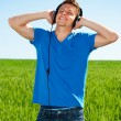 Man listening music with pleasure - Stock Photo