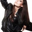 Sexy woman in leather coat — Stock Photo
