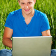 Smiley guy with computer — Stock Photo