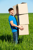 Man carrying boxes — Stock Photo