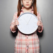 Young woman holding wall clock — Stock Photo