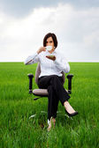 Businesswoman with white cup of coffee — Stock Photo