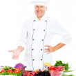 Handsome senior chef with vegetables — Stock Photo