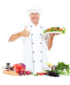 Cheerful cook showing thumbs up — Stock Photo