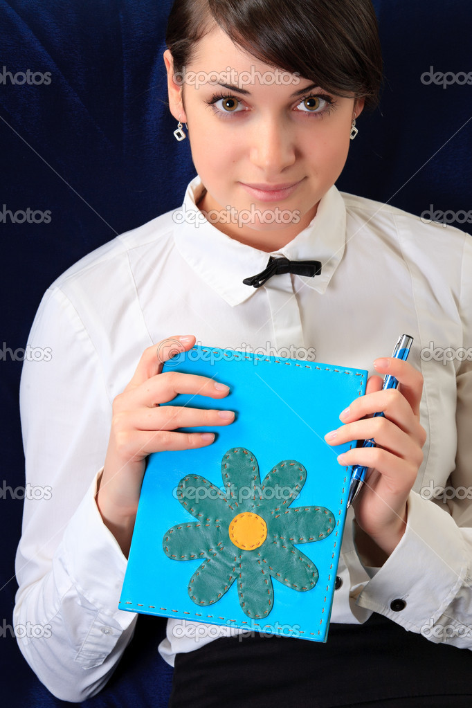 Student and notebook. Close up.  Stock Photo #6270987