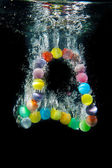 Beads under water — Stock Photo
